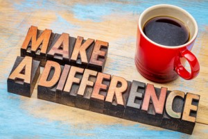 make a difference - motivational words in vintage letterpress wood type with a cup of coffee