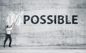 "Man turning the word ""Impossible"" into ""Possible"""